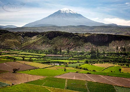 Snow-capped Misti Volcano in background with mountains and green farmland surrounding