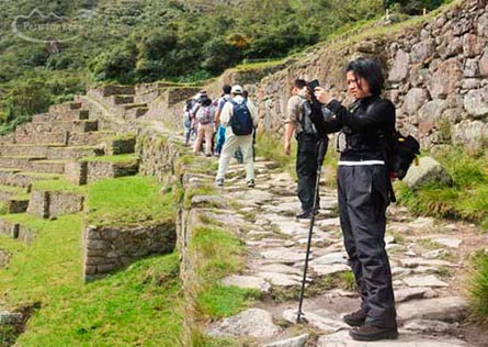 Traveler taking a photo from the sector of Machu Picchu terraces