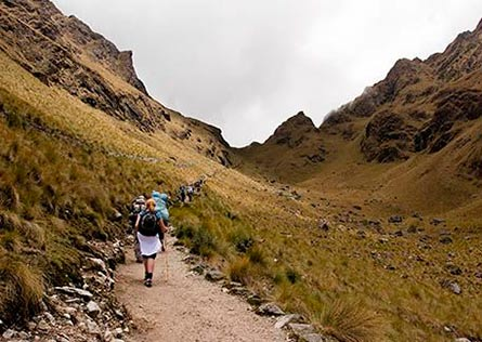 Travelers walking up Dead Womans Pass along the Inca Trail