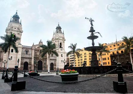 White Cathedral with two bell towers bordering the Plaza de Armas of Lima