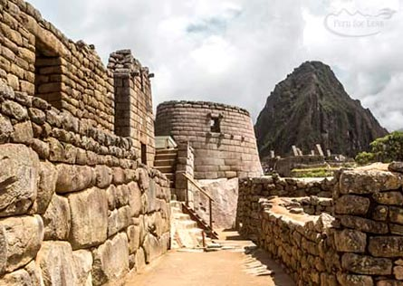 View of the curved stone structure of the Sun Temple at Machu Picchu