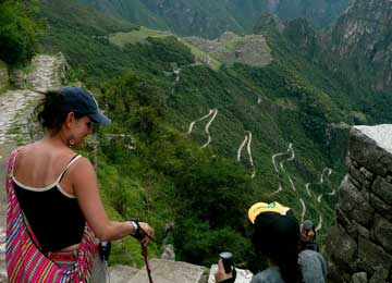 Trekkers overlook a mountain slope with the zigzag road to Machu Picchu