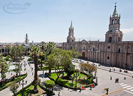 View down on the Arequipa plaza at the large white Cathedral.