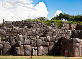 Three rows of walls constructed of large stones of the Sacsayhuaman ruins