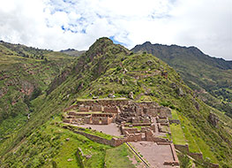 View of Pisac ruins atop a hill with the Sacred Valley on either side