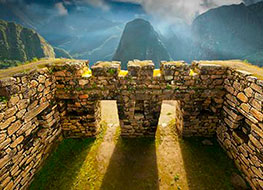 Sun and jungle mist cast light and shadows on Machu Picchu