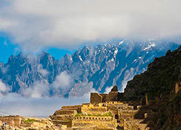 Inca ruins with a snowy mountain range as a backdrop