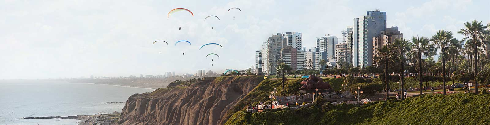 Paragliders in flight along the cliff coastline of Miraflores