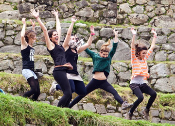 Visitors jump in the air for a playful Machu Picchu portrait