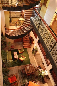 Spiral staircases and a comfortable lobby await guests at the Hotel Punuypampa in Puno, Peru.