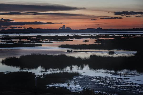 The sunset over the marshlands of Lake Titicaca, Peru