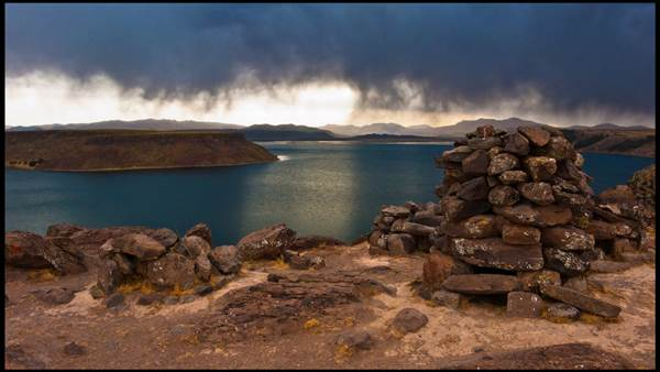 A storm hovers over  Lake Titicaca, Peru