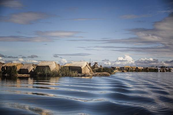 Small reed huts constructed on the Floating Islands of Uros, Lake Titicaca, Peru