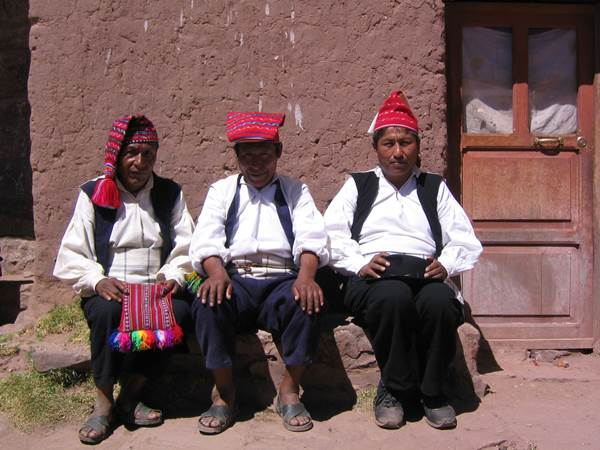 People in traditional dress. The man wears a chumpi