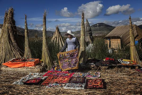 Uros woman displays handicrafts for sale