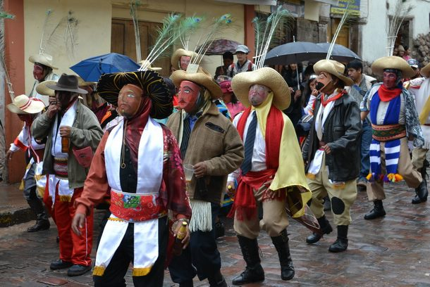 Costumed participants in a Christmas parade on the streets of Cusco