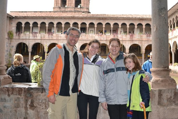 The Miller family pose in a colonial building